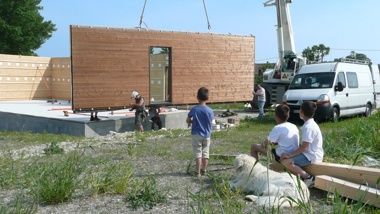 Chantier construction maison bois cologique ecop habitat for Assurance chantier construction maison