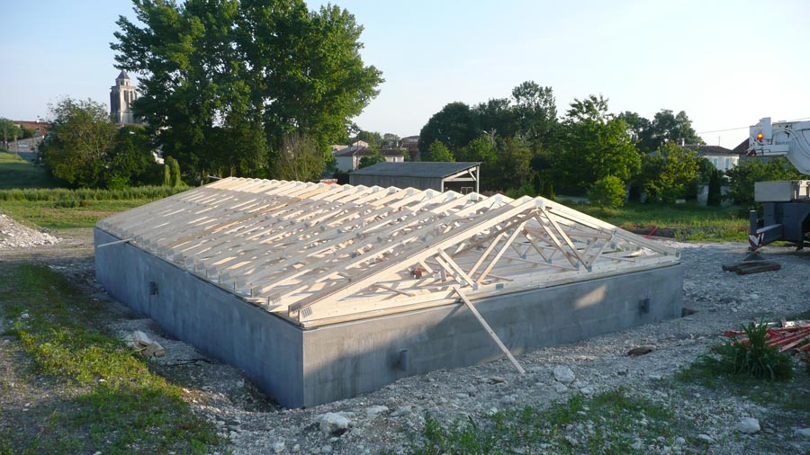 Chantier construction maison bois cologique ecop habitat for Maison en plaque de beton